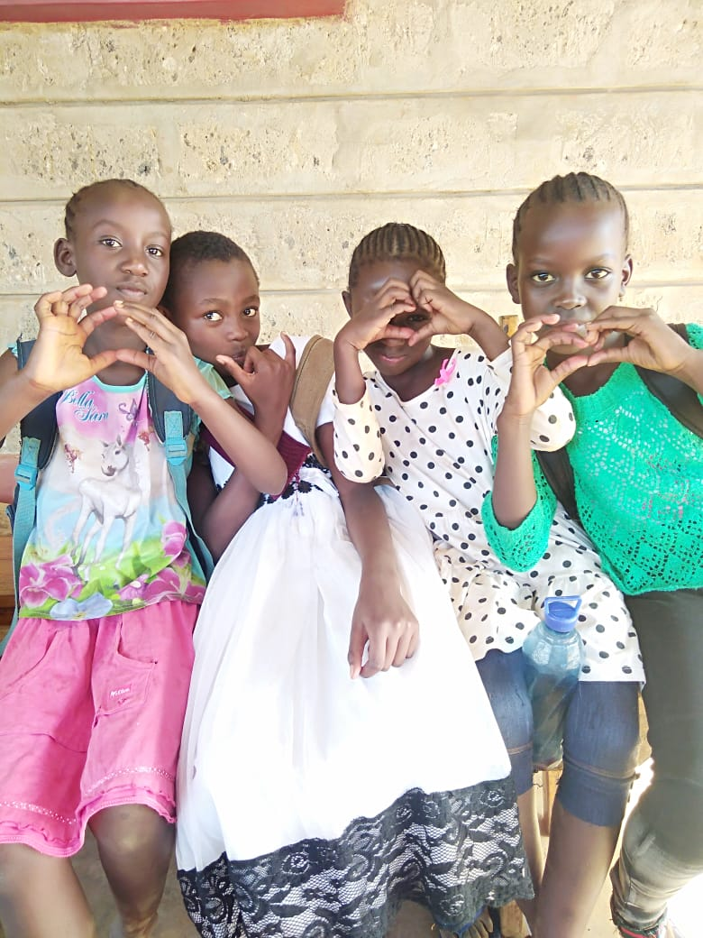 Girls making hearts - The Fursa Trust