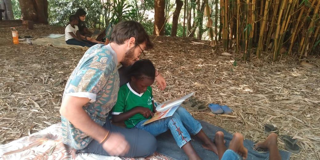 Matteo helping to read - The Fursa Trust